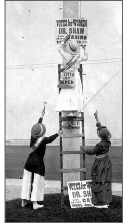 putting up suffrage posters